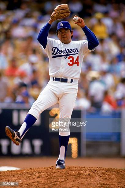 Fernando Valenzuela of the Los Angeles Dodgers winds up a pitch during a game at Dodger Stadium in Los Angeles California Valenzuela played for the...