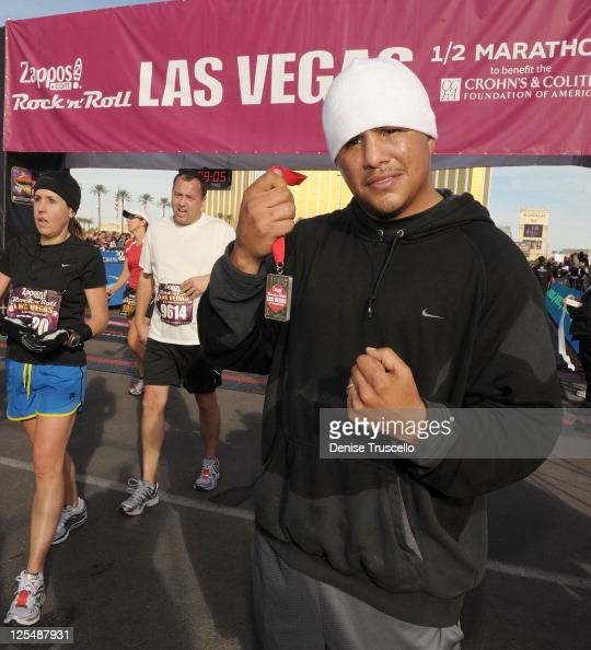 Fernando Vargas crosses the finish line at Zapposcom Rock 'n' Roll Las Vegas Marathon and HalfMarathon to benefit the Chron's and Colitis Foundation...