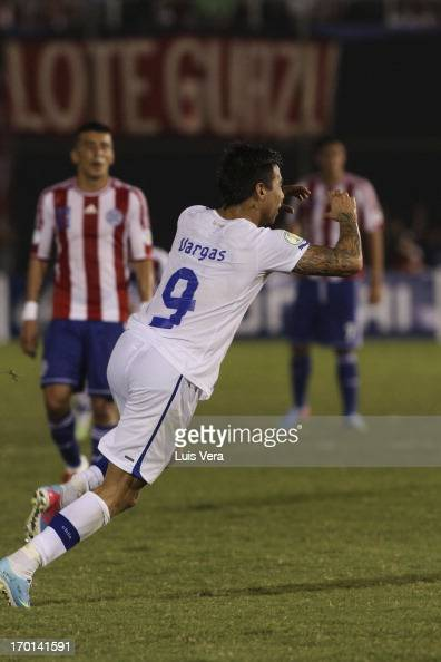 Fernando Vargas of Chile celebrates a scored goal against Paraguay during the match as part of the South American Qualifiers for FIFA World Cup...