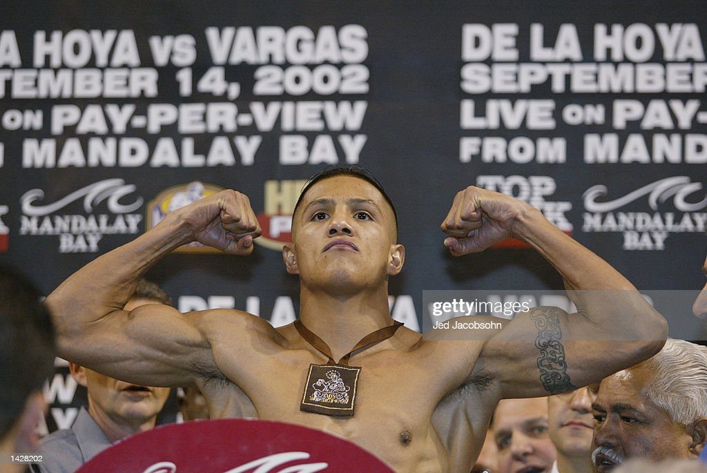 Fernando Vargas poses on the scale at the weigh-in before his World Super Welterweight/Jr. Middleweight Championship fight against Oscar De La Hoya on September 14th at the Mandalay Bay Events Center on September 13, 2002 in Las Vegas, Nevada. Vargas weighed in at 154 pounds.