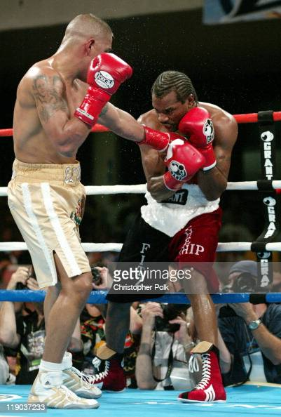 Fernando Vargas right tan trunks fights against Fitz Vanderpool red trunks during a 10Round Junior Middleweight bout at the Grand Olympic Auditorium...