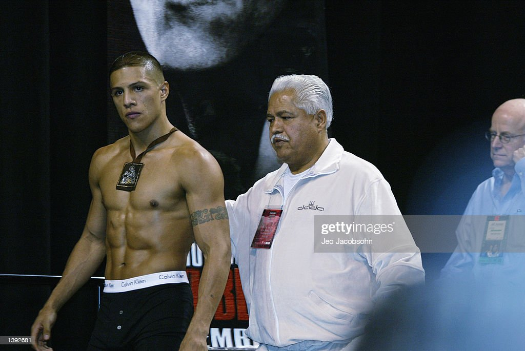 Fernando Vargas walks in with trainer Eduardo Garcia at the weigh-in before his fight against Oscar De La Hoya on September 14 at the Mandalay Bay Events Center on September 13, 2002 in Las Vegas, Nevada. Vargas weighed in 154 pounds.