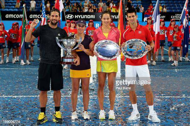Fernando Verdasco and Anabel Medina Garrigues of Spain together with Ana Ivanovic and Novak Djokovic of Serbia pose with their trophies after the...