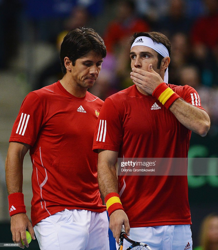 <a gi-track='captionPersonalityLinkClicked' href=/galleries/search?phrase=Fernando+Verdasco&family=editorial&specificpeople=213930 ng-click='$event.stopPropagation()'>Fernando Verdasco</a> and <a gi-track='captionPersonalityLinkClicked' href=/galleries/search?phrase=David+Marrero&family=editorial&specificpeople=5357971 ng-click='$event.stopPropagation()'>David Marrero</a> of Spain react during their Double match against Tommy Haas and Philipp Kohlschreiber of Germany on Day 2 of the Davis Cup First round match between Germany and Spain at Fraport Arena on February 1, 2014 in Frankfurt am Main, Germany.