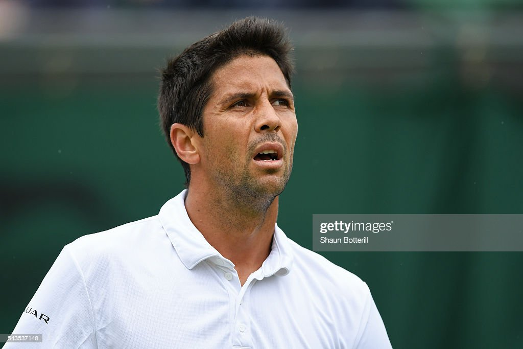 <a gi-track='captionPersonalityLinkClicked' href=/galleries/search?phrase=Ivan+Dodig&family=editorial&specificpeople=4888715 ng-click='$event.stopPropagation()'>Ivan Dodig</a> of Croatia looks on during the Men's Singles first round match against Tomas Berdych of The Czech republic on day three of the Wimbledon Lawn Tennis Championships at the All England Lawn Tennis and Croquet Club on June 29, 2016 in London, England.