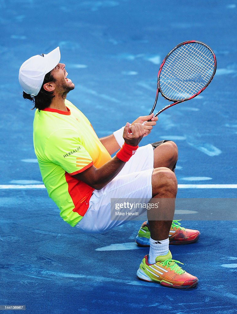 Fernando Verdasco of Spain collapses onto the blue clay having beaten Rafael Nadal of Spain in the 4th round of the Mutua Madrilena Madrid Open at the Caja Magica on May 10, 2012 in Madrid, Spain.