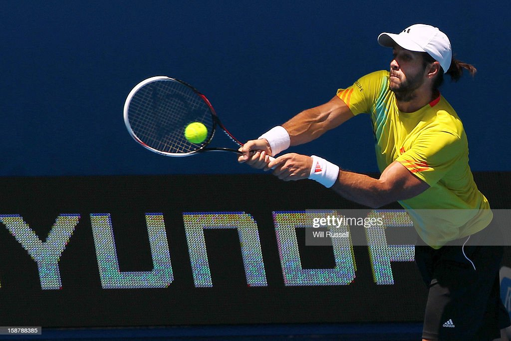 Fernando Verdasco of Spain hits a backhand in the opening match between Spain and South Africa during day one of the Hopman Cup at Perth Arena on December 29, 2012 in Perth, Australia.
