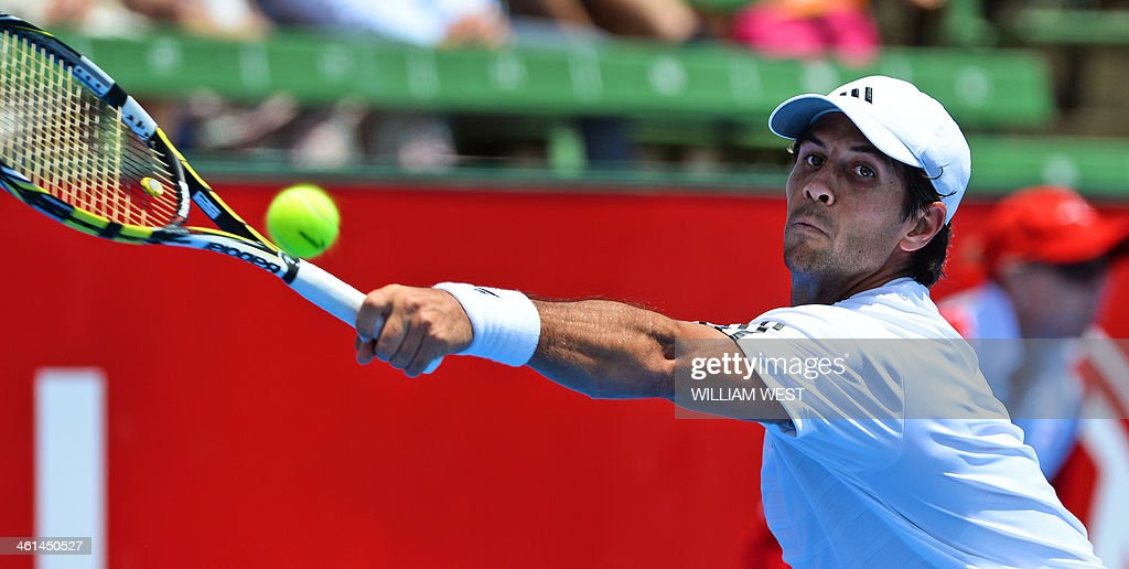 Fernando Verdasco of Spain hits a backhand return in his match with Grigor Dimitrov of Bulgaria at the invitational Kooyong Classic tennis tournament...