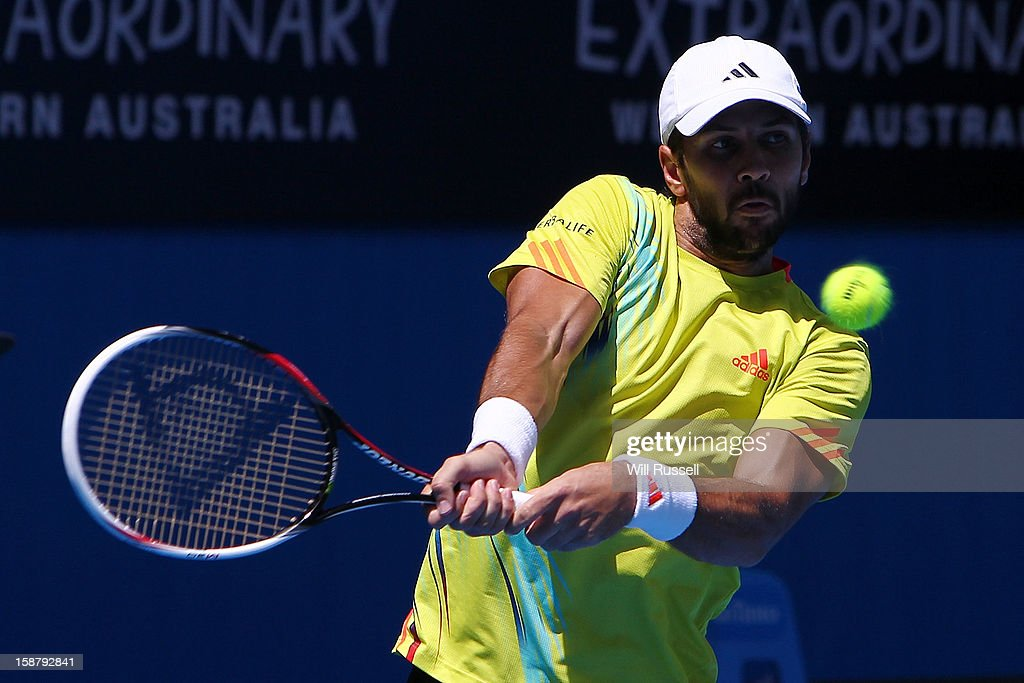 Fernando Verdasco of Spain hits a forehand shot in his Group B singles match against Kevin Anderson of South Africa during day one of the Hopman Cup at Perth Arena on December 29, 2012 in Perth, Australia.