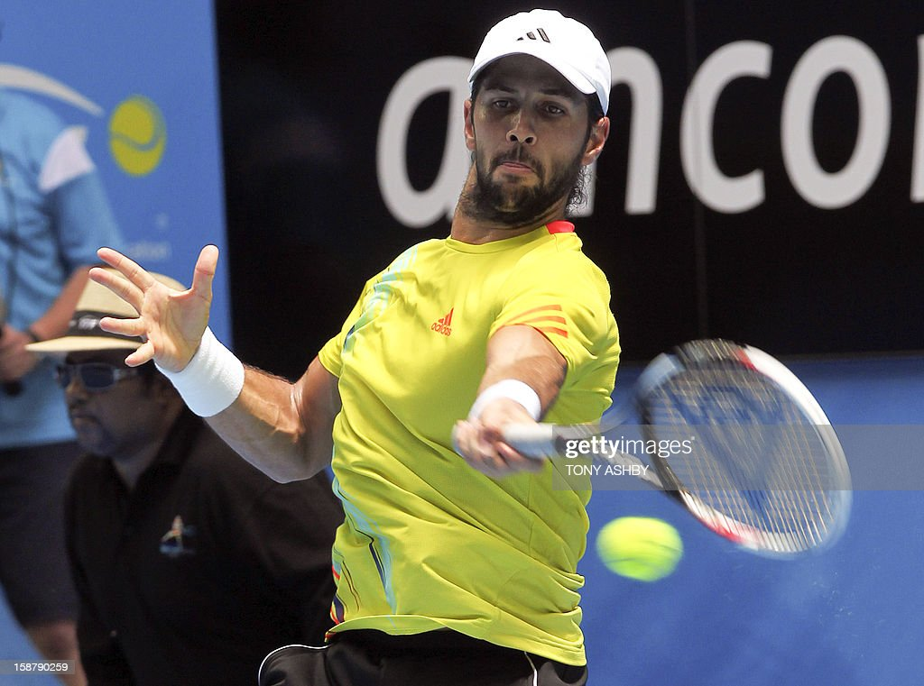 Fernando Verdasco of Spain hits a return against Kevin Anderson of South Africa during their first session men's singles match on day one of the Hopman Cup tennis tournament in Perth on December 29, 2012. AFP PHOTO/Tony ASHBY USE