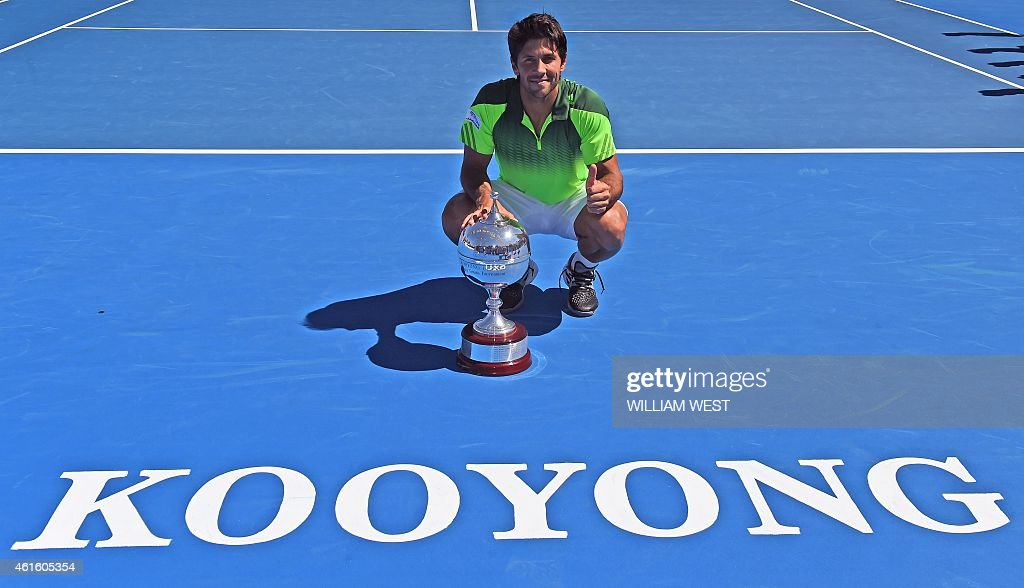 Fernando Verdasco of Spain holds the trophy after winning the Kooyong Classic tennis event in Melbourne on January 16 2015 Verdasco defeated Alexandr...
