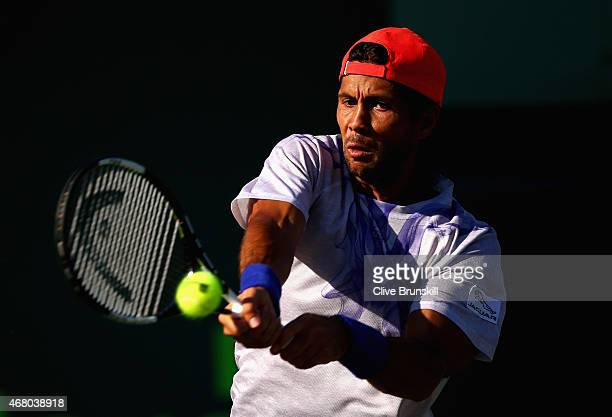 Fernando Verdasco of Spain plays a backhand against Rafael Nadal of Spain in their third round match during the Miami Open Presented by Itau at...