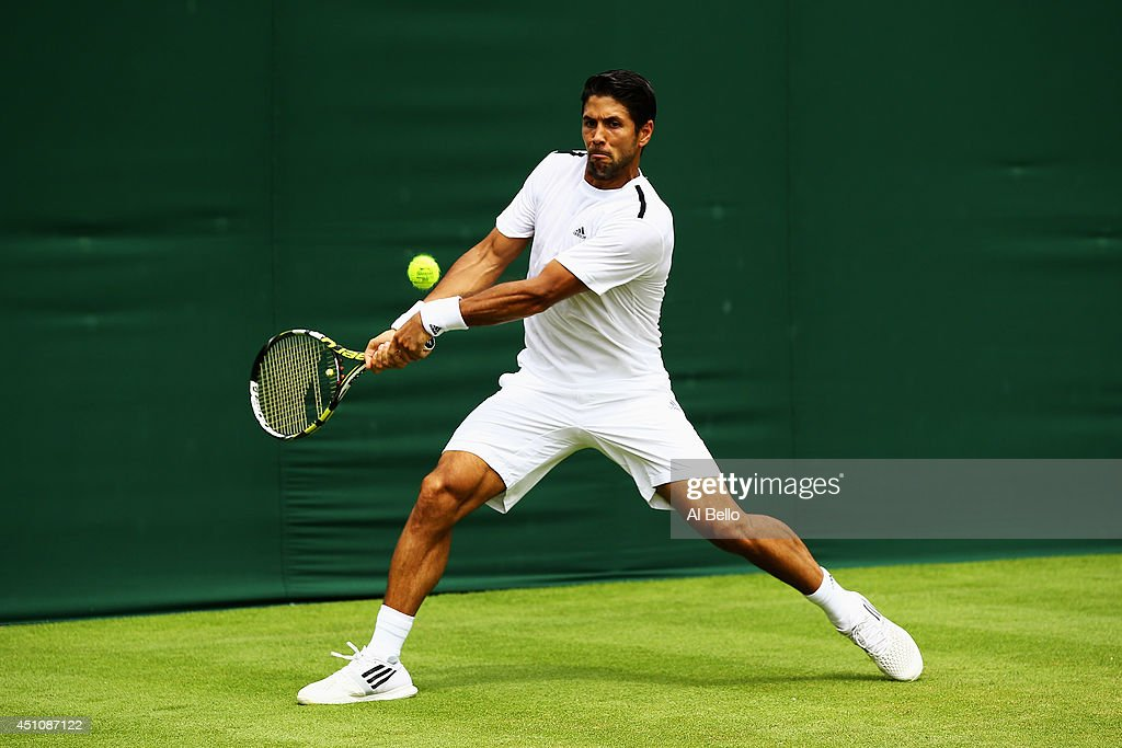 <a gi-track='captionPersonalityLinkClicked' href=/galleries/search?phrase=Fernando+Verdasco&family=editorial&specificpeople=213930 ng-click='$event.stopPropagation()'>Fernando Verdasco</a> of Spain plays a backhand during his Gentlemen's Singles first round match against Marinko Matosevic of Australia on day one of the Wimbledon Lawn Tennis Championships at the All England Lawn Tennis and Croquet Club at Wimbledon on June 23, 2014 in London, England.