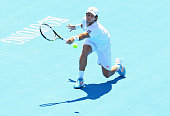 Fernando Verdasco of Spain plays a backhand during his match against Tomas Berdych of the Czech Republic during day one of the 2014 AAMI Classic at...