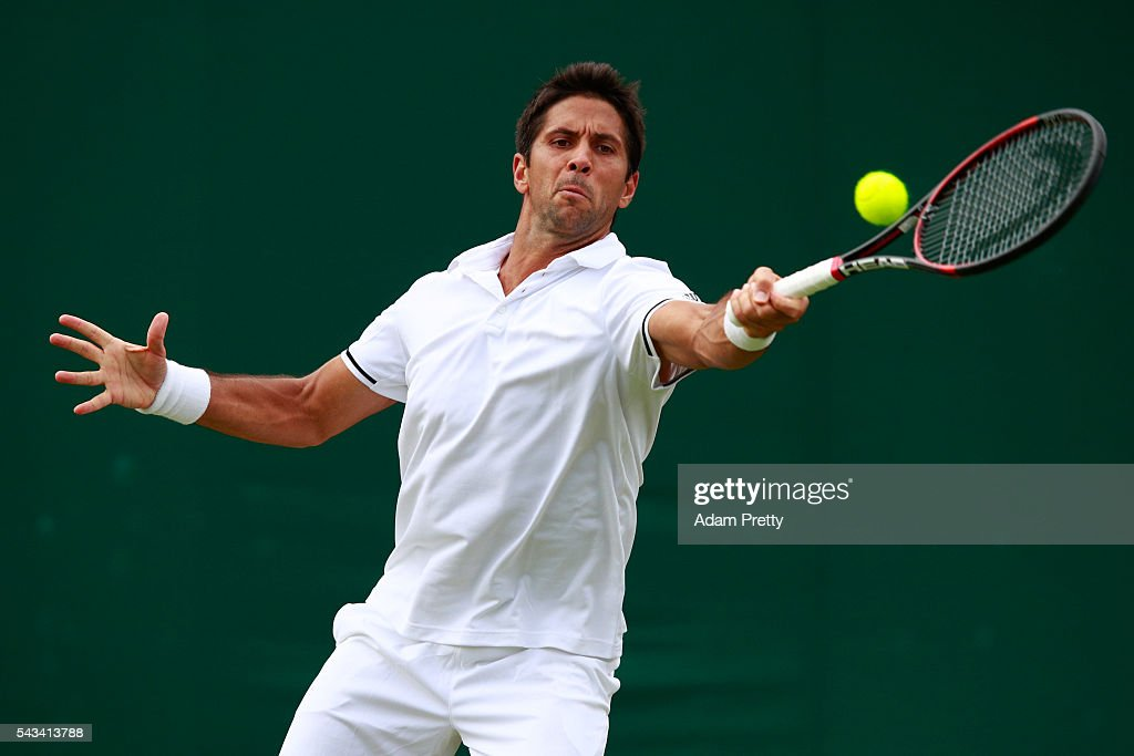 <a gi-track='captionPersonalityLinkClicked' href=/galleries/search?phrase=Fernando+Verdasco&family=editorial&specificpeople=213930 ng-click='$event.stopPropagation()'>Fernando Verdasco</a> of Spain plays a backhand during the Men's Singles first round match against Bernard Tomic of Australia on day two of the Wimbledon Lawn Tennis Championships at the All England Lawn Tennis and Croquet Club on June 28, 2016 in London, England.