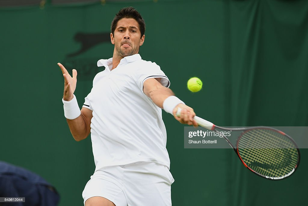 <a gi-track='captionPersonalityLinkClicked' href=/galleries/search?phrase=Fernando+Verdasco&family=editorial&specificpeople=213930 ng-click='$event.stopPropagation()'>Fernando Verdasco</a> of Spain plays a forehand during the Men's Singles first round match against Bernard Tomic of Australia on day three of the Wimbledon Lawn Tennis Championships at the All England Lawn Tennis and Croquet Club on June 29, 2016 in London, England.