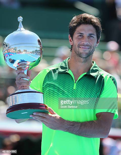 Fernando Verdasco of Spain poses with the trophy after defeating Alexandr Dolgopolov of Ukraine in the Championship Match to win the tournament...