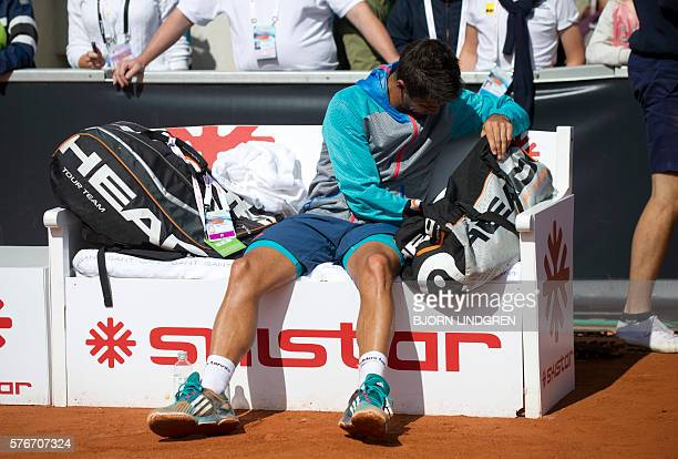 Fernando Verdasco of Spain reacts after loosing to Albert RamosVinolas of Spain during the final tennis match at the Swedish Open in Bastad Sweden on...