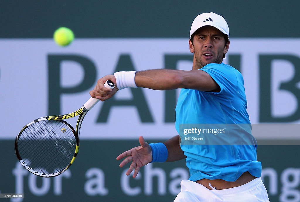 <a gi-track='captionPersonalityLinkClicked' href=/galleries/search?phrase=Fernando+Verdasco&family=editorial&specificpeople=213930 ng-click='$event.stopPropagation()'>Fernando Verdasco</a> of Spain returns a forehand to John Isner during the BNP Paribas Open at Indian Wells Tennis Garden on March 12, 2014 in Indian Wells, California.