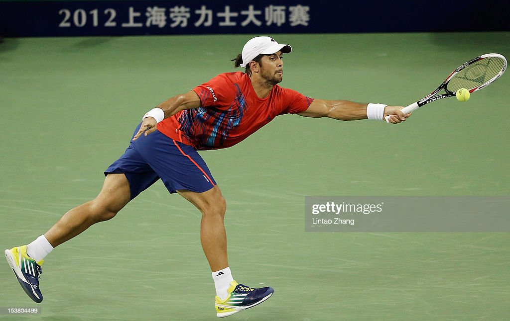 Fernando Verdasco of Spain returns a shot to Juan Monaco of Argentina during day three of Shanghai Rolex Masters at the Qi Zhong Tennis Center on October 9, 2012 in Shanghai, China.