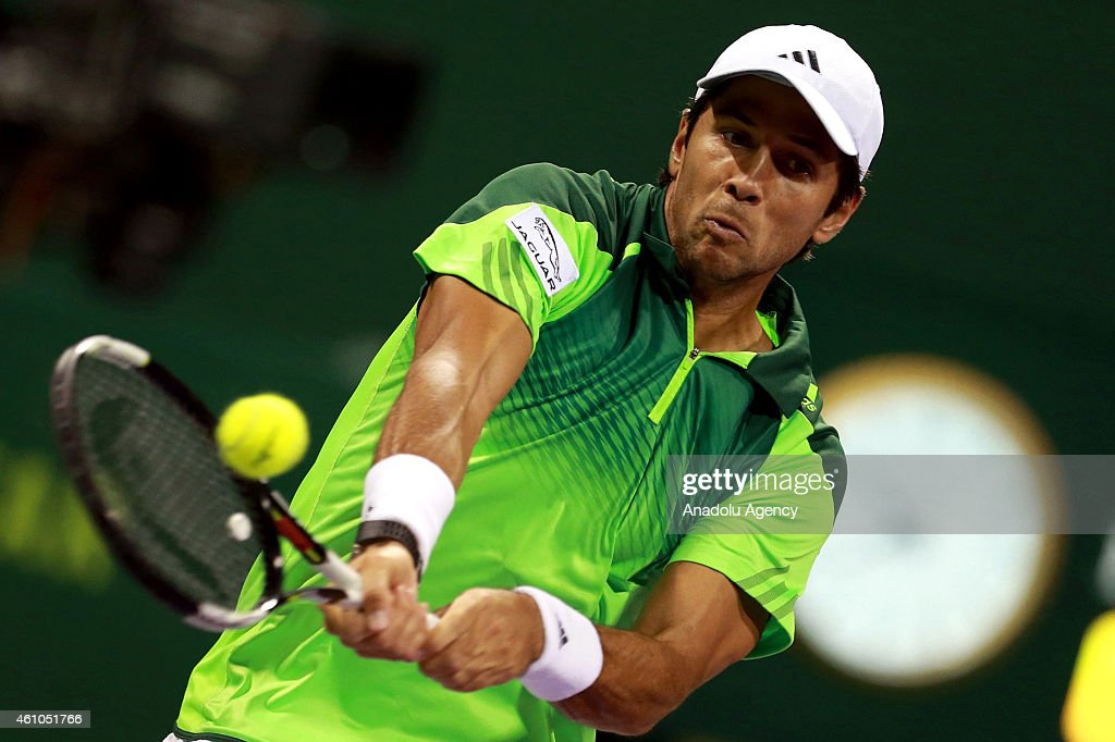 Fernando Verdasco of Spain returns the ball to Russian tennis player Teymuraz Gabashvili during their tennis match in the Qatar's ExxonMobil Open at...