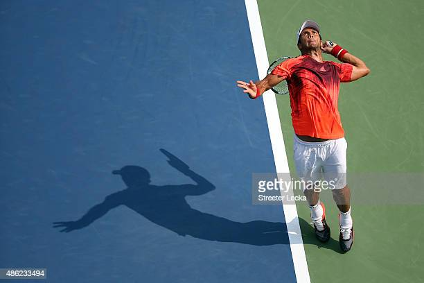 Fernando Verdasco of Spain serves against Milos Raonic of Canada against during their Men's Singles Second Round match on Day Three of the 2015 US...
