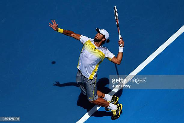 Fernando Verdasco of Spain serves in his first round match against David Goffin of Belgium during day one of the 2013 Australian Open at Melbourne...