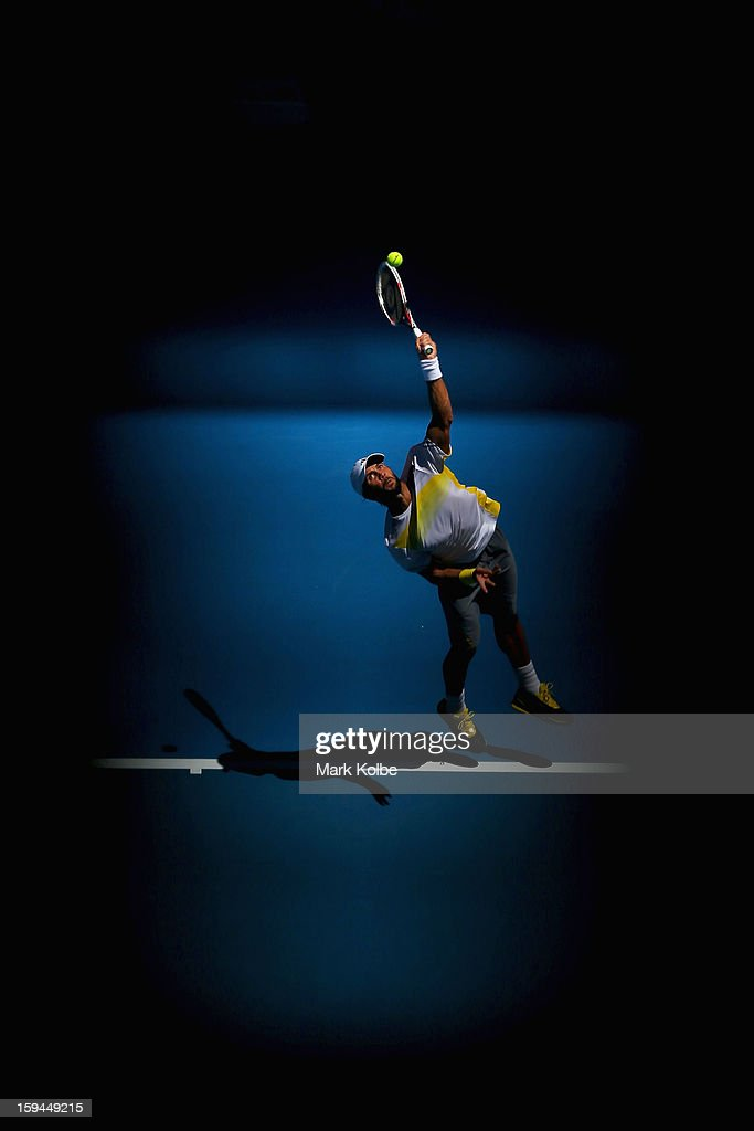 <a gi-track='captionPersonalityLinkClicked' href=/galleries/search?phrase=Fernando+Verdasco&family=editorial&specificpeople=213930 ng-click='$event.stopPropagation()'>Fernando Verdasco</a> of Spain serves in his first round match against David Goffin of Belgium during day one of the 2013 Australian Open at Melbourne Park on January 14, 2013 in Melbourne, Australia.