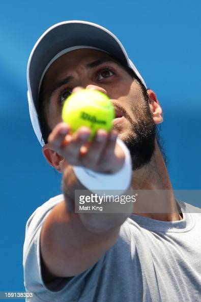 Fernando Verdasco of Spain serves in his second round match against Denis Istomin of Uzbekistan during day four of the Sydney International at Sydney...