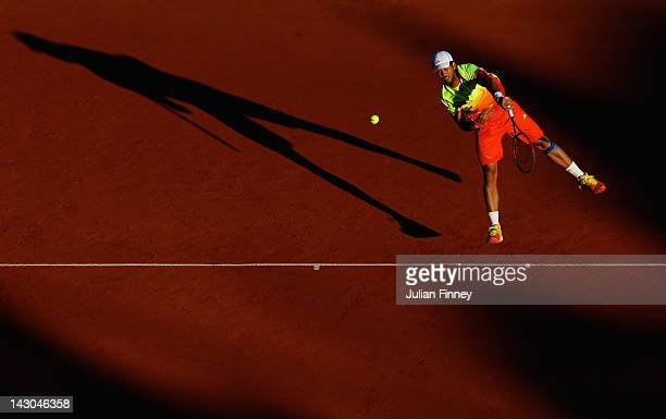 Fernando Verdasco of Spain serves in the doubles match with partner David Marrero against Michael Llodra of France and Nenad Zimonjic of Serbia...