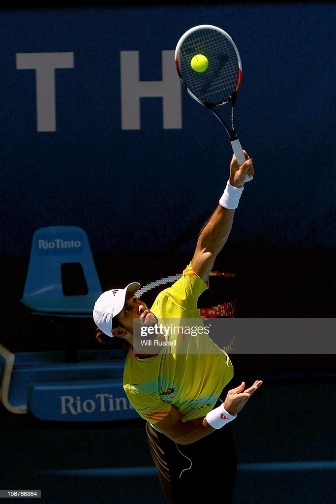 Fernando Verdasco of Spain serves in the opening match between Spain and South Africa during day one of the Hopman Cup at Perth Arena on December 29, 2012 in Perth, Australia.
