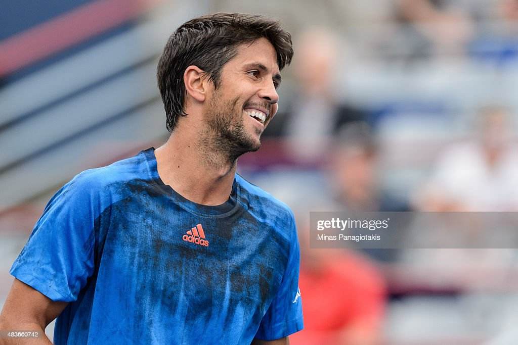 <a gi-track='captionPersonalityLinkClicked' href=/galleries/search?phrase=Fernando+Verdasco&family=editorial&specificpeople=213930 ng-click='$event.stopPropagation()'>Fernando Verdasco</a> of Spain smiles at his opponent Nick Kyrgios of Australia during day two of the Rogers Cup at Uniprix Stadium on August 11, 2015 in Montreal, Quebec, Canada.