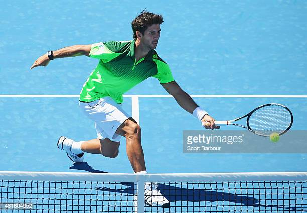 Fernando Verdasco of Spain stretches for the ball during the Championship Match against Alexandr Dolgopolov of Ukraine during day four of the...