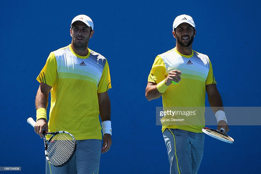 Fernando Verdasco of Spain talks tactics in his second round doubles match with David Marrero of Spain against Tomasz Bednarek and Jerzy Janowicz of Poland during day six of the 2013 Australian Open at Melbourne Park on January 19, 2013 in Melbourne, Australia.