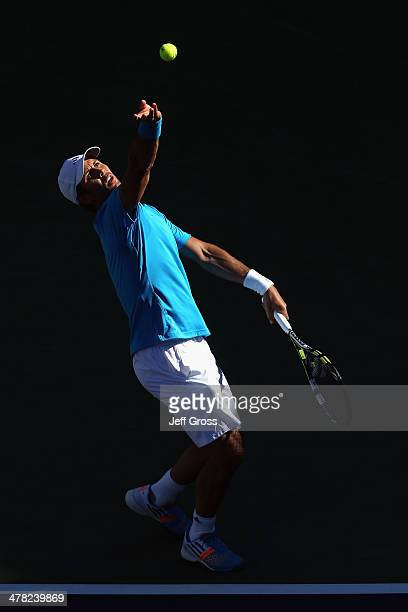 Fernando Verdasco of Spain tosses the ball up before serving to John Isner during the BNP Paribas Open at Indian Wells Tennis Garden on March 12 2014...