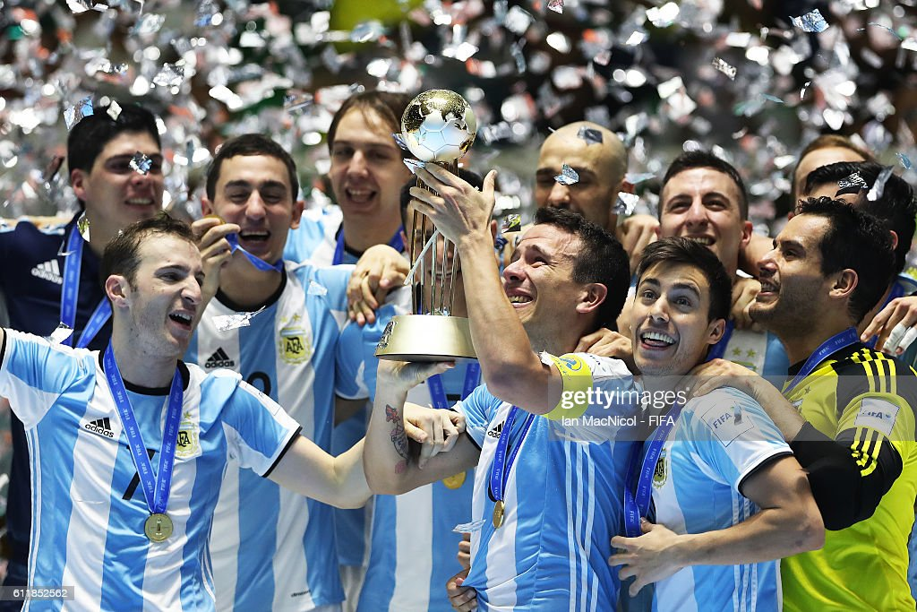 Fernando Wilhelm of Argentina holds the trophy during the FIFA Futsal World Cup Final match between Russia and Argentina at the Coliseo el Pueblo Stadiumon October 1, 2016 in Cali, Colombia.