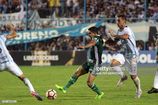 Fernando Zampedri of Argentina's Atletico Tucuman vies for the ball with Dudu of Brazil's Palmeiras during their Copa Libertadores football match in...