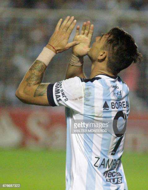 Fernando Zampedri of Atletico Tucuman celebrates tafter scoring against Uruguay's Penarol during their Copa Libertadores football match at the Jose...
