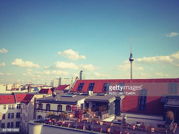 Fernsehturm And Buildings In City Against Blue Sky