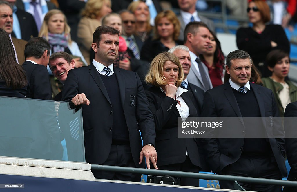 Ferran Soriano the CEO and Vicky Kloss the chief communications officer of Manchester City look on prior to the Barclays Premier League match between Manchester City and Norwich City at Etihad Stadium on May 19, 2013 in Manchester, England.