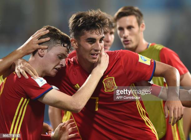 Ferran Torres of Spain celebrates with teammates after scoring a goal during the second semi final football match between Mali and Spain in the FIFA...