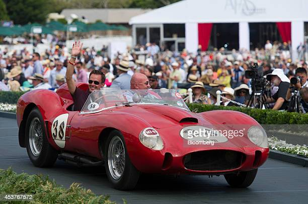 Ferrari 250 Testa Tossa Scaglietti Spyder is driven by Tom Hartley Jr left over the winners ramp during the 2014 Pebble Beach Concours d'Elegance in...