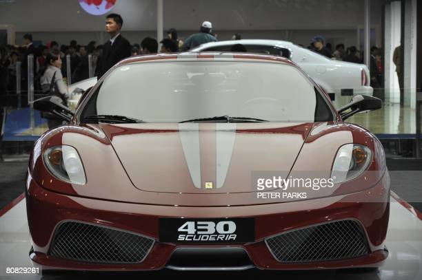 A Ferrari 430 Scuderia sportscar is on display at the Beijing Auto Show on April 23 2008 The world's top carmakers descended in force for the...
