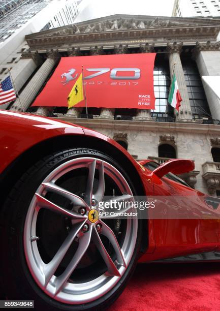 A Ferrari 488 GTB in front of the NYSE after Ferrari NV led by Chairman Sergio Marchionne and members of the companys leadership team ring the...