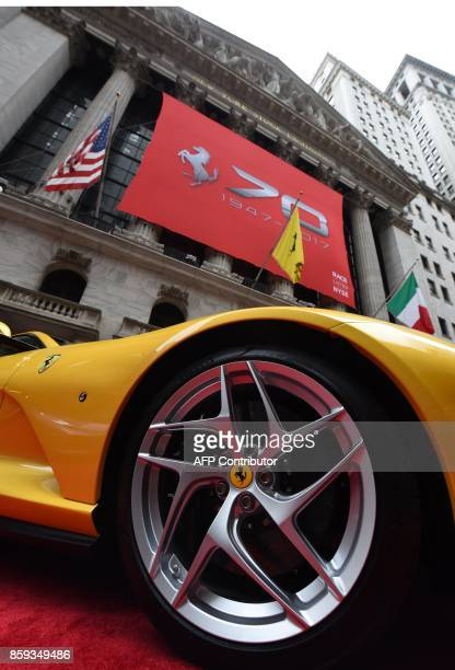 A Ferrari 812 Superfast in front of the NYSE after Ferrari NV led by Chairman Sergio Marchionne and members of the companys leadership team ring the...