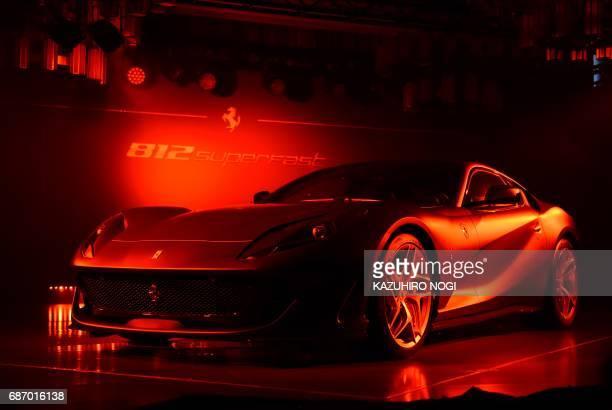 A Ferrari 812 Superfast is diplayed at a press conference for Japanese media in Tokyo on May 23 2017 The 812 Superfast made its debut at the Geneva...