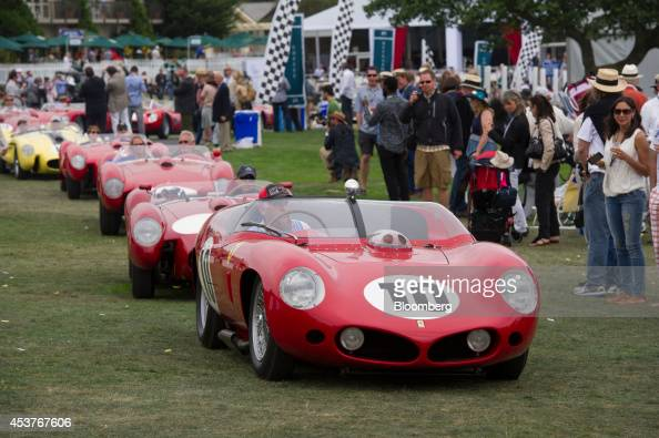Ferrari automobiles line up to exit the concourse during the 2014 Pebble Beach Concours d'Elegance in Pebble Beach California US on Sunday Aug 17...