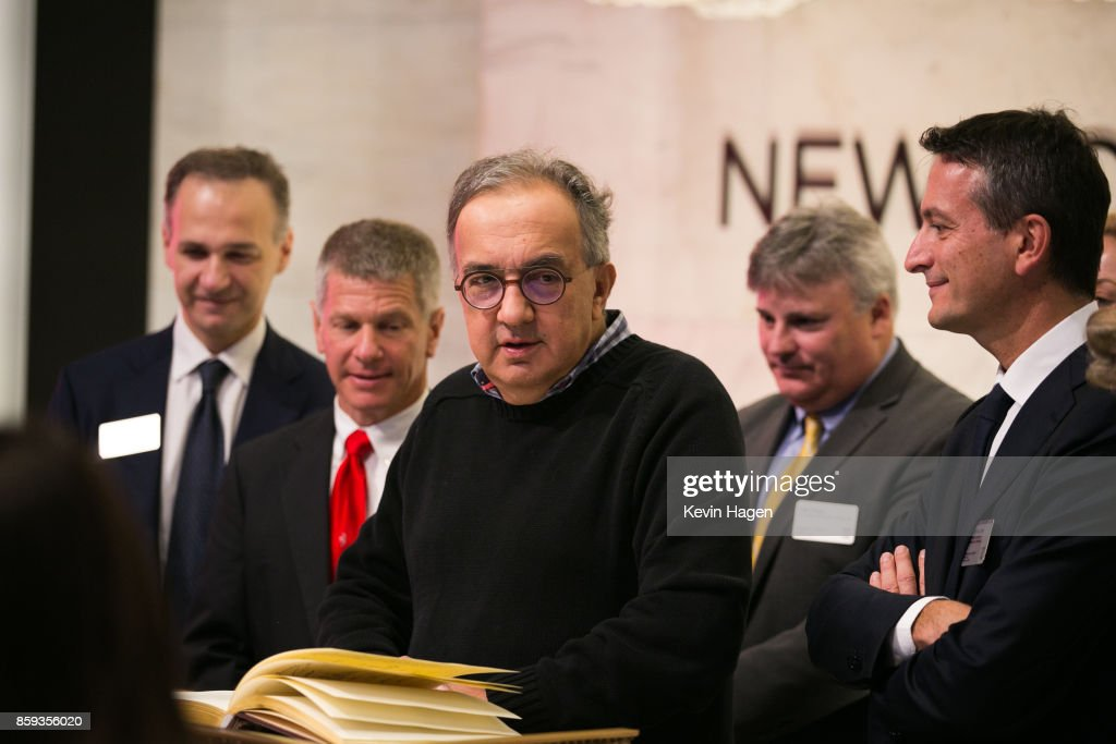 Ferrari Chairman Sergio Marchionne poses at the guest book before ringing the opening bell, commemorating his company's 70th anniversary, at the New York Stock Exchange on October 9, 2017 in New York City.