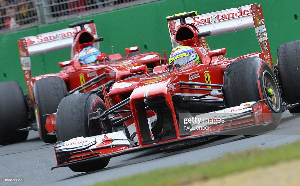 Ferrari driver Felipe Massa (R) of Brazil powers through a corner ahead of Ferrari's Fernando Alonso of Spain during the Formula One Australian Grand Prix in Melbourne on March 17, 2013. IMAGE RESTRICTED TO EDITORIAL USE - STRICTLY NO COMMERCIAL USE AFP PHOTO / Paul CROCK