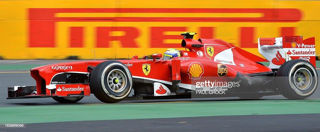 Ferrari driver Felipe Massa of Brazil powers through a corner during the Formula One Australian Grand Prix in Melbourne on March 17, 2013. AFP PHOTO / Paul CROCK USE